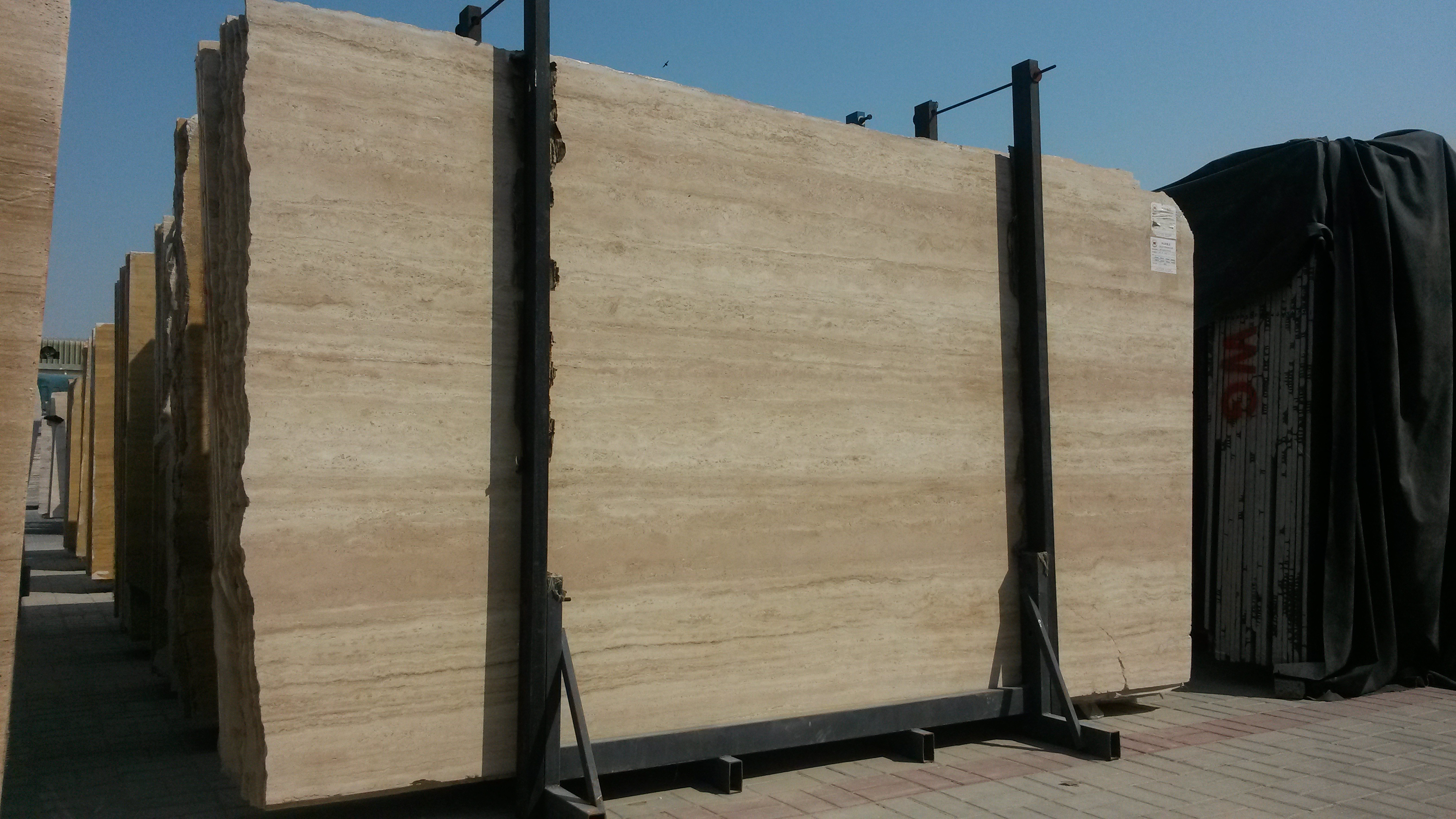 EXTRA LIGHT BEIGE TRAVERTINE SLABS AND TILES.
